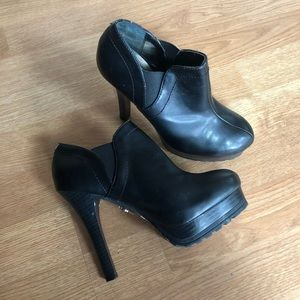 Black heeled booties, size 6.